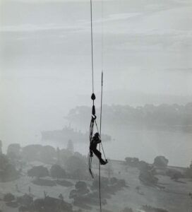 Lot 305 - Dogman, 1962, est. $1,500-2,500. A Rope with a View